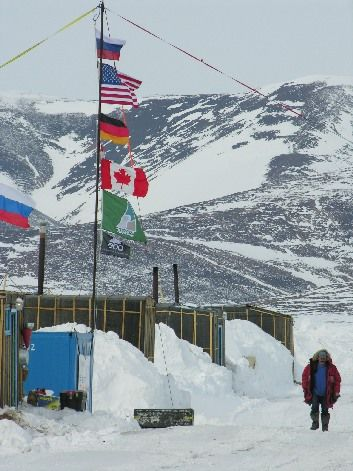 The international expedition flags extend in the arctic wind at Camp El'gygytgyn