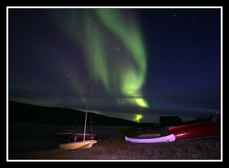 Aurora Borealis rises over Lake Fergusson August 24, 2009. Thanks to Ed Stockard for all of his contributions to field notes.
